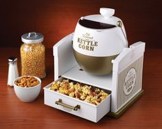 Kettle Corn Maker - It makes 12 cups of delicious kettle corn per batch and comes with a funnel for adding oil, popcorn and sugar.