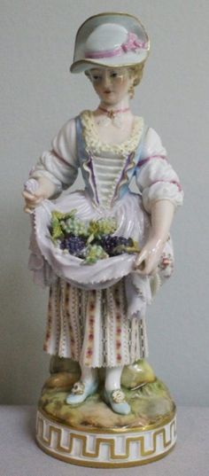 19TH C. MEISSEN FIGURE OF A WOMAN WITH GRAPES IN HER APRON