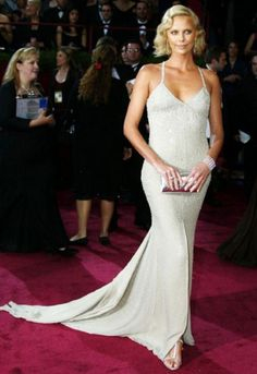Charlize Theron in Gucci, 2004    Statuesque Charlize Theron channelled Twenties chic for the night she won her Best Actress Oscar in 2004. Her delicately beaded Gucci gown and finger-waved blonde 'do meant she not only topped the winners chart, but the fashion chart too.