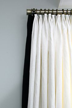 White linen drapes with black banding and Old Gold Hardware by Tonic Living for @iheartorganizing