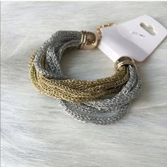 Chain bracelet Chain bracelet. Brand new with tags. Clasp closure with extender. Gold and silver color combination. Looks like a chain, but has a string texture Price is firm unless bundled. No tradesAVAILABILITY- 3.                                       All jewelry gets a great discount when bundled!! Jewelry Bracelets