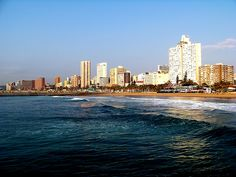 Durban is South Africa's third largest city and is quite a study of diversity. With a large population of Zulu, almost half, there exists a strong Indian influence as well. Durban South Africa, Art Deco Buildings, Kwazulu Natal, Modern City, Africa Travel, Best Cities, Day Tours, Great Places, New York Skyline
