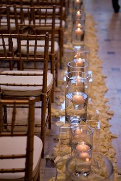 Floating candles line the aisle for this elegant wedding at the Asian Art Museum. #mccallssf #mccallscatering #mccallsfloral #aisledecor