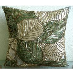 Pillow Cover is made in a dull green color Art Silk Dupioni Fabric embroidered with different shades of green sequins to create a camouflages of leaves on the surface of the pillow cover. My inspiration behind this design was nature and the lovely green color which is so much in