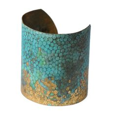 Hammered brass bangle with a hand-worked verdigris finish