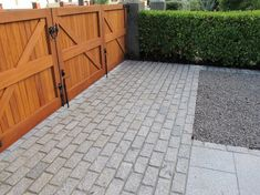 Granite driveway entrance design, simple, stylish and secure.