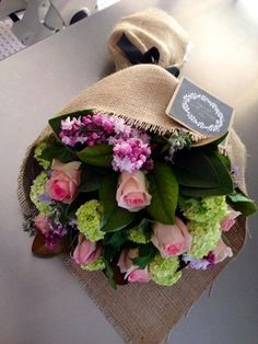 A beautiful bouquet wrapped in burlap... Lovely! The Flower Girl Studio Gorgeous flowers and wrapping
