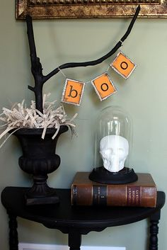"boo! Spray paint branch black and add  your own created ""boo"" banner with string; create vignette with other Halloween decor."