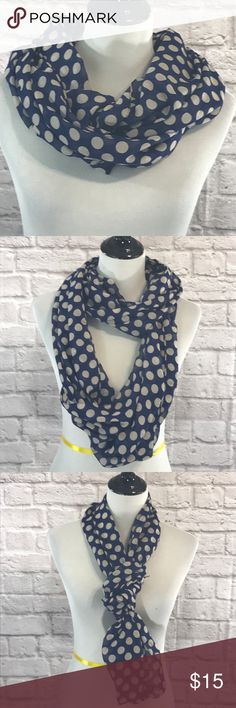 Navy infinity scarf with white polkadots Navy infinity scarf with white polkadots. The scarf is in excellent condition. Please see pictures for details and measurements. Thanks for visiting my closet! Accessories Scarves & Wraps
