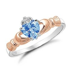 Sterling Silver Claddagh Ring Rose Gold Plated with Simulated Aquamarine Stone Size 4 Kriskate & Co. http://www.amazon.com/dp/B0069WI7D0/ref=cm_sw_r_pi_dp_49Advb0FNJ9X1