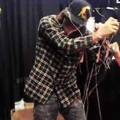 [Gif] Norman playing with silly string, with a kid... ♥