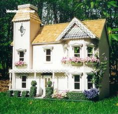 dollhouse with gorgeous landscaping and window boxes. On doll house store site. Has pictures of same house done different ways.