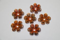 6 Copper Colored Vintage Flowers - domed and center drilled. $3.00, via Etsy.