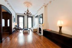 Looks like primo sock-sliding real estate. – The Best of Lena Dunham's House Hunting Expeditions Brownstone Interiors, Townhouse, Brooklyn House, Nyc Real Estate, Brick Facade, Large Windows, Luxury Apartments, Home Furnishings, Property For Sale