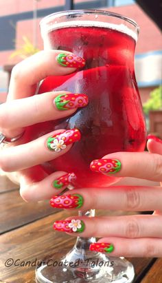 Strawberry manicure done with soak-off gel and hand sculpted acrylic 3-D flowers.