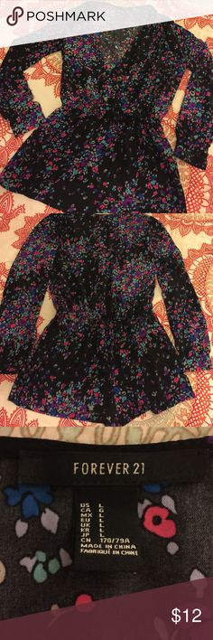 Forever 21 Floral Romper black based floral print with hints of teals, purples, pinks and reds // 100 % polyester // stretchy waistband // small button clasp on cleavage line // no pockets or zippers // never been worn! Forever 21 Other