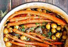 This hearty Slow Cooker Beef Pot Roast with vegetables is so tender it will melt in your mouth! It's perfect comfort food and very affordable. Add potatoes, carrots, root veggies, squash or sweet potato to suit your taste. Leftovers make great sandwiches or use them in a hash.