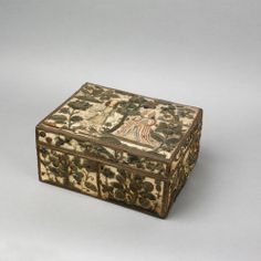 "Charles II elaborate needlework casket, mid 17th c., with raised work flowers, insects, birds, fruit trees, and man and woman on an ivory satin ground, 6 1/4"" h., 12 1/2"" w., 10"" d. Provenance: Herbert Schiffer, 1965."