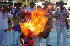 Barranquilla, Colombia: A fire-breather performs during carnival celebrations.     Photograph: Fernando Vergara/AP