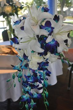 Bridal Bouquet with Oriental Lillies, Blue Orchids and Eskimo Roses.