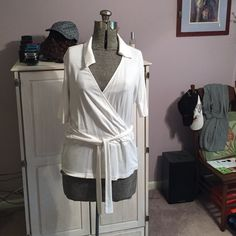 Faux wrap top in white. Jones of New York faux wrap top with belt and slight peplum. Jones New York Tops Blouses