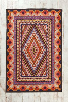 Magical Thinking Diamond Medallion Rug $69 - Love the mix of warm and cool colors in this rug! #urbanoutfitters