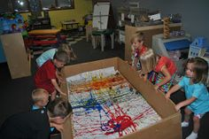 Super Sized Marble Painting... This would be fun for a group of toddlers.  Maybe tape smaller pieces together so each kid gets a piece of art to take home.