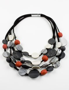 Granada Necklace by Klara Borbas. Four strand faux suede carries two sided…