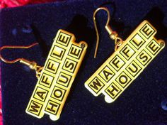 Approximately in gold toned metal and yellow and black plastic are these fabulous WAFFLE HOUSE earrings. Wire pierced earrings hold the LOGO for the famous restaurant. Add to your collection or wear for your love of waffles. Waffle Waffle, Waffle House, Pierced Earrings, Etsy Earrings, Waffles, Buy And Sell, Metal, Gold, Handmade