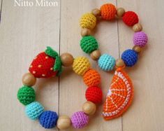Items similar to Waldorf wooden teether Crochet teething ring Rainbow nursing bracelet Breastfeeding Busy toddler toy Beads for baby to play Knit strawberry on Etsy Toddler Gifts, Toddler Toys, Crochet Wrist Warmers, Rainbow Crochet, Nursing Necklace, Teething Toys, Crochet Bracelet, Baby Rattle, Crochet Dolls