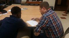 Mentor Samuel Burden tutoring a CYDC youth in our Bakker Career Center this week. ‪#‎youthmentoring‬ ‪#‎volunteering‬
