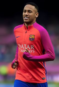 Neymar warms up before the La Liga match between FC Barcelona and Malaga CF at Camp Nou stadium on November 19, 2016 in Barcelona.