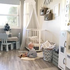 White and Gray Nursery with White Stokke Sleepi Crib and Canopy