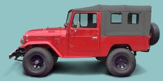 Testing different FJ43 colors and wheel types: freeborn red, gray soft-top, modern black wheels.