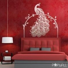 Hmmmmm. I like the idea of a faux headboard with a peacock perched on top for my bedroom.....in the right colors of course!