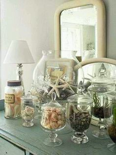 seashells ! Great display idea. I'd like one filled with shells from each place we vacation.