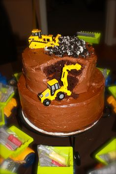 Construction theme birthday party cake by: @Christina Childress Childress Childress Jefferson  I like the idea of the bulldozer pushing stuff along the top of the cake.