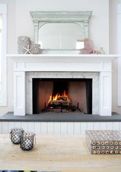White fireplace mantel with bluestone surround, seascape Design ...