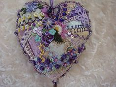 The art of crazy quilting -- an embellished, lavender-stuffed heart.  gatherings100.blogspot.com