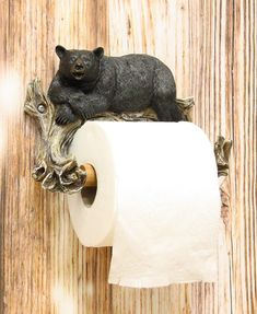 • Could your bathroom use a bit of rustic humor and whimsy? Entertain your guests with nature's acknowledgement of their proceedings in the bathroom. When they reach for the bath tissue, family members or visitors to your home or office will be treated to the sight of a lazy black bear looking at them while dispensing the paper they need. Combine this roll holder with other bathroom accessories to complete your lodge or cabin theme.• This detailed bear is the result of skilled craftsmanship and Cabin Bathrooms, Lodge Bathroom, Pedestal Toilet Paper Holder, Hunting Lodge Decor, Bear Decor, Wall Mounted Toilet, Bathroom Wall Decor, Bathroom Ideas, Black Bear