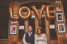 Gold wedding balloons spelling out the word LOVE.  http://www.noeldeasington.com/