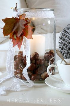 Like the idea of displaying chestnuts in a large glass jar - would leave out the ribbon and leaves though.