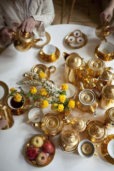 Tea with textile artist Alice Kettle and her glorious collection of golden tea-sets. Photography by Marina Loram. Styling by Poppy Koumis.