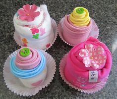 Cupcakes made out of baby clothes... cute idea for a baby shower