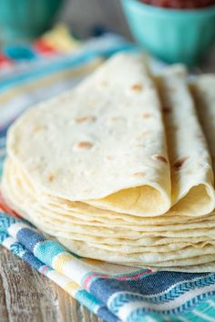 Ever Homemade Flour Tortillas Photo of a stack or Best Ever Homemade Flour Tortillas resting on a Mexican designed cloth on a wood table.Photo of a stack or Best Ever Homemade Flour Tortillas resting on a Mexican designed cloth on a wood table. Uncooked Tortillas, Recipes With Flour Tortillas, Homemade Flour Tortillas, Coconut Flour Tortillas, How To Make Tortillas, Mexican Dishes, Mexican Food Recipes, Vegan Recipes, Cooking Recipes