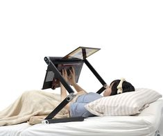 This Japanese piece of brilliance, the Super Gorone Desk, is going to do wonders for the angles and positions from which I can watch porn in bed. And the lying down laptop stand looks like it adjusts for seated positions too, which will make it way ea