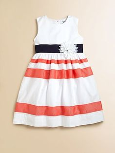 A bright and cheery frock with colorful stripes and delicate flower is a seasonal go-to for day or night.