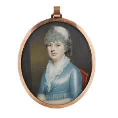 """John Jukes (English, 1772-1851) <br />  <br /> portrait miniature of a lady <br />  <br /> Oval portrait on ivory of a lady in silk dress and lace collar seated in an interior, signed and dated """"Jukes 1798"""", in gilt metal frame, the reverse with blue glass and plaited hair border encircling a seed pearl anchor; together with an oval portrait on ivory of a lady in blue dress and black lace shawl and white lace cap, attributed to Moses Griffith. (2). <br />  <br /> H: 3 5/8 in. <br />  <br…"""