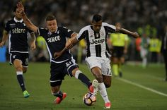 Alex Sandro of FC Juventus compete for the ball with Sergej Milinkovic Savic of SS Lazio during the TIM Cup Final match between SS Lazio and Juventus FC at Olimpico Stadium on May 17, 2017 in Rome, Italy.
