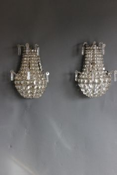 Here are a sweet pair of French Antique Wall Lights, with quality cut crystal stringing. Take a closer look at - http://www.antiquelightingandchandeliers.co.uk/pair-of-superior-french-1930-octagon-cut-mirr_item_10764